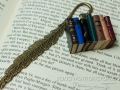 Bookmark with handmade miniature leather books and feather charm
