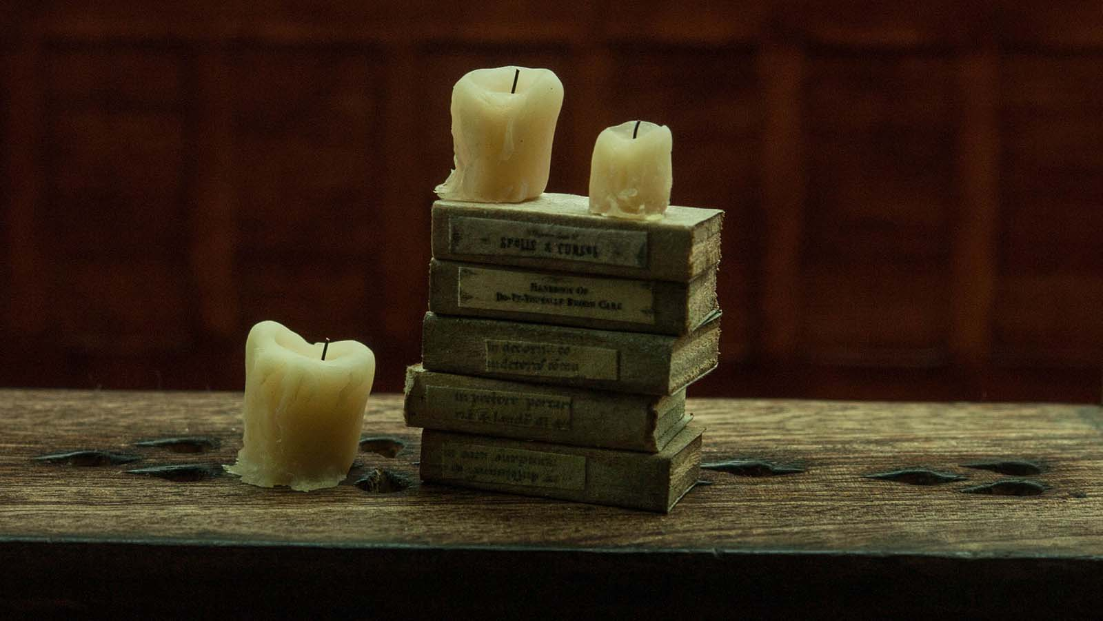 Miniature polymer clay candles. Old drippy waxy transparent look candles