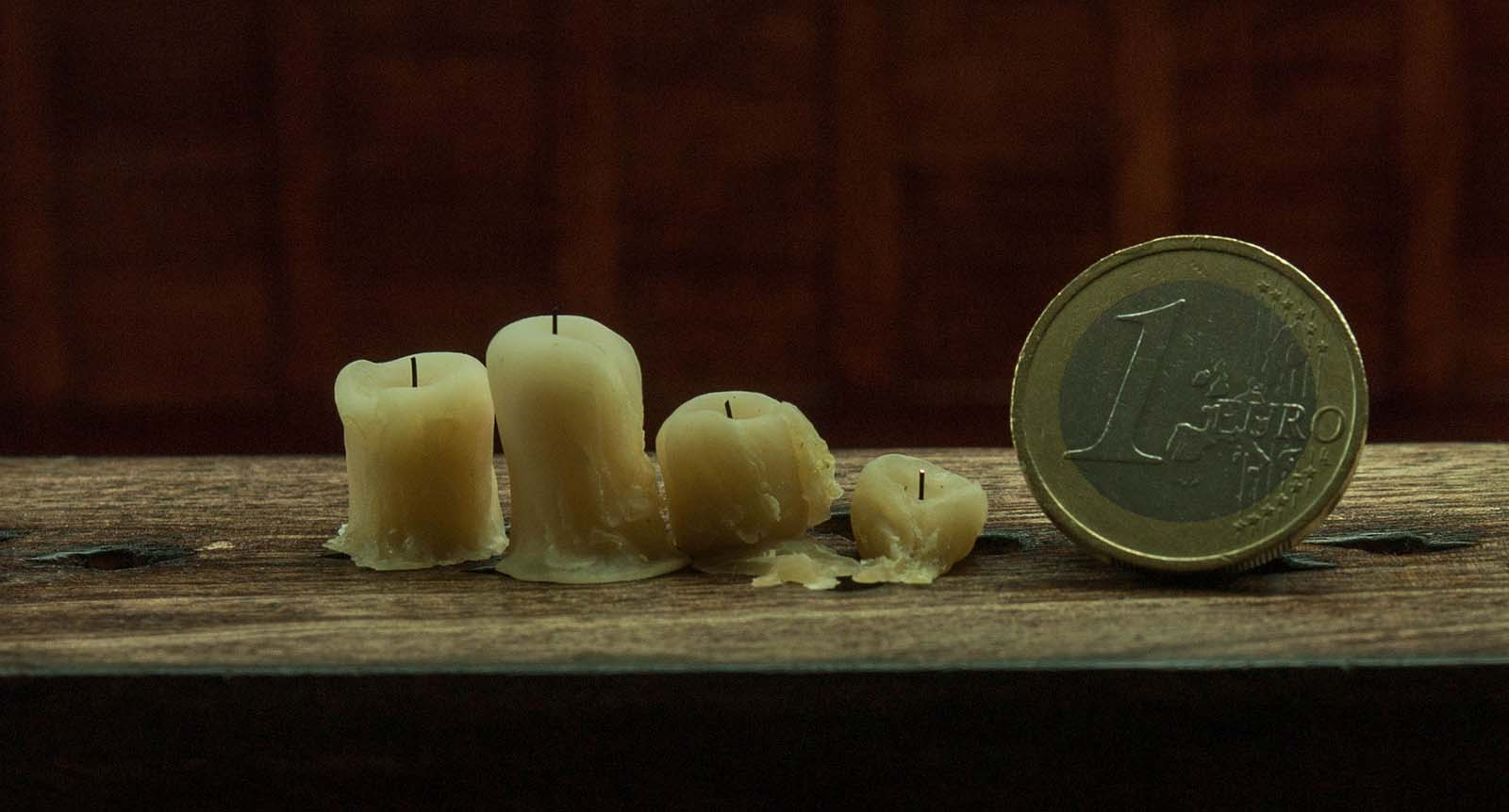 Miniature polymer clay candles. Old drippy waxy candles