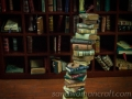 Miniature book stack with spooky mask