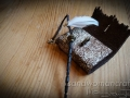 Miniature leather art journal with magic wand and white feather