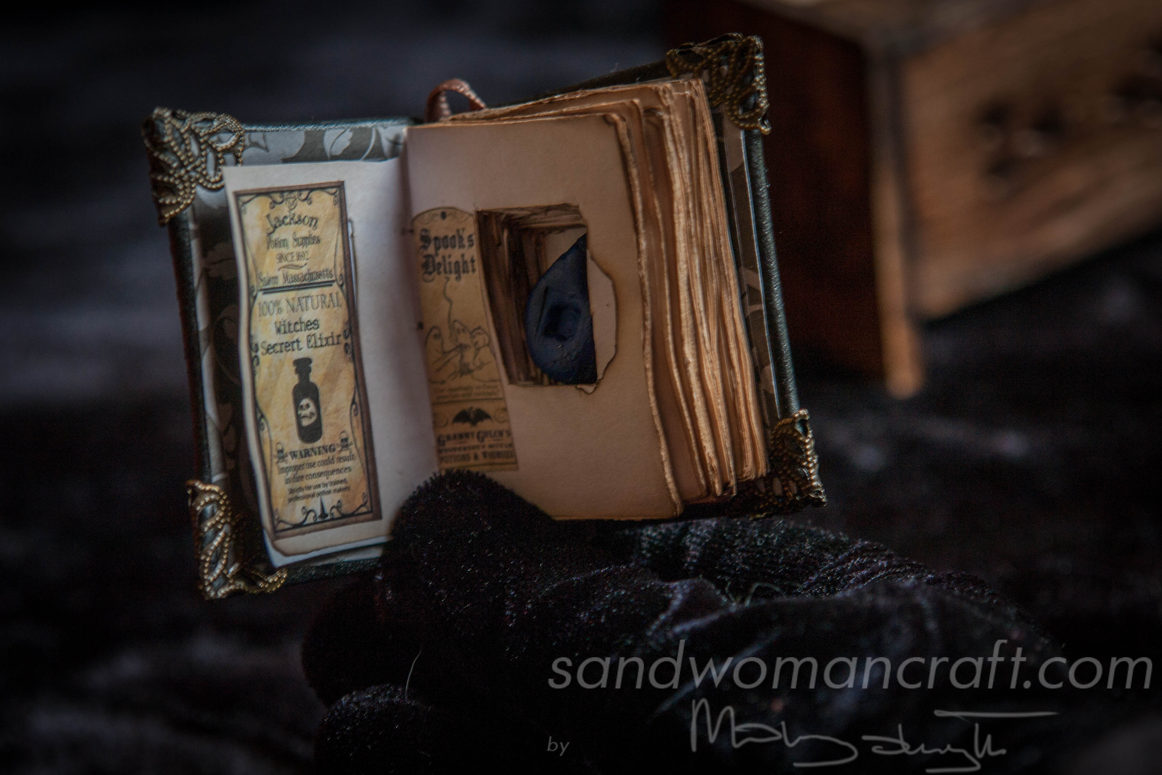 Black leather miniature book with brass skull and hidden potion inside