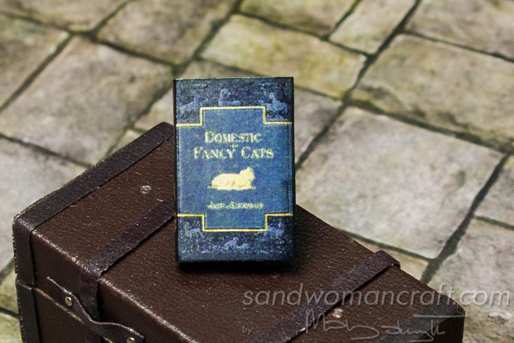 Miniature paper book domestic fancy cats