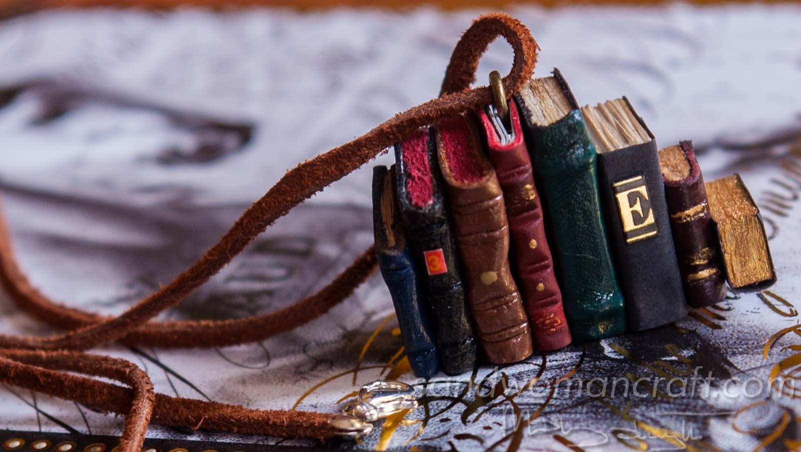 Miniature leather book necklace with charm made out of eight books