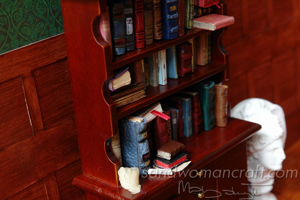 Bookcase with miniature books in 1:12 scale (1 inch scale). My private collection.