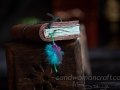 Miniature book. Brown leather with feather