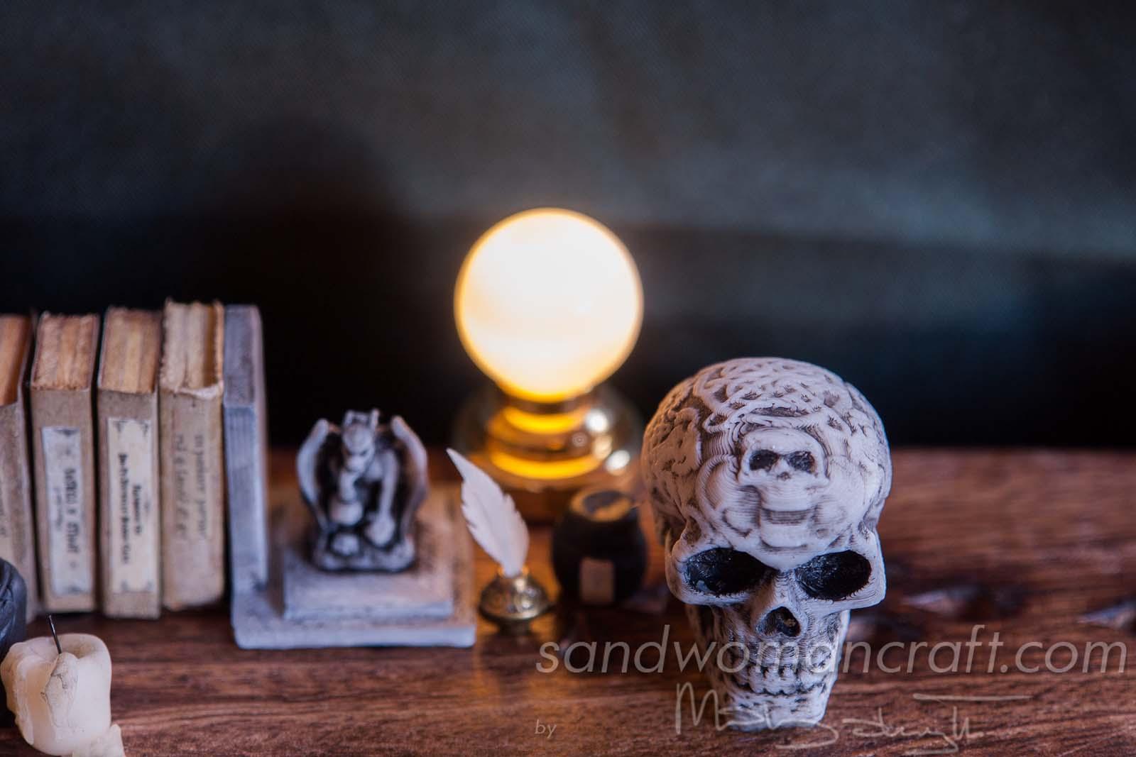 Miniature celtic skull, candles, book, lamp