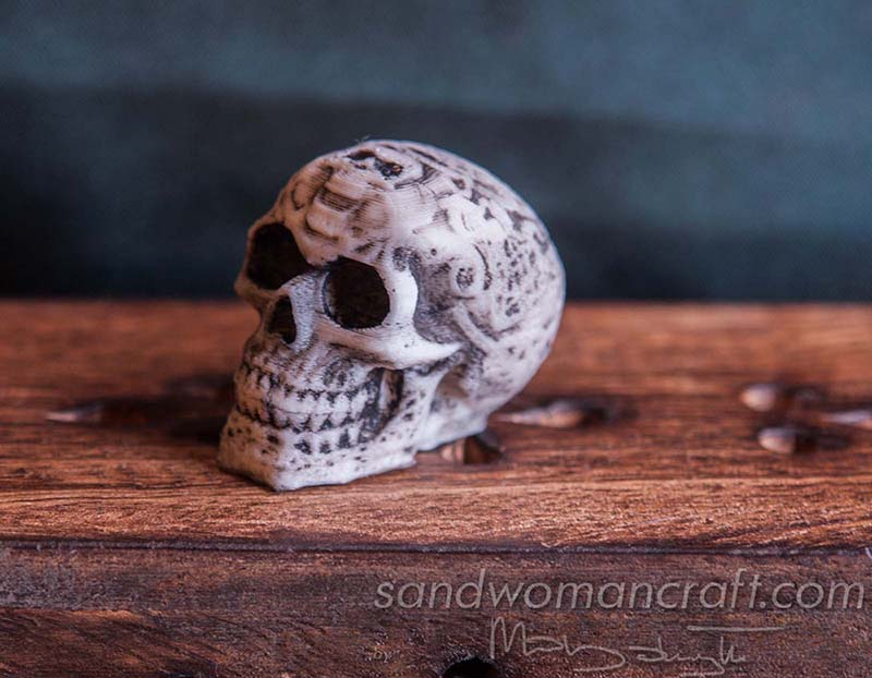 Miniature celtic skull, candles, book, lamp
