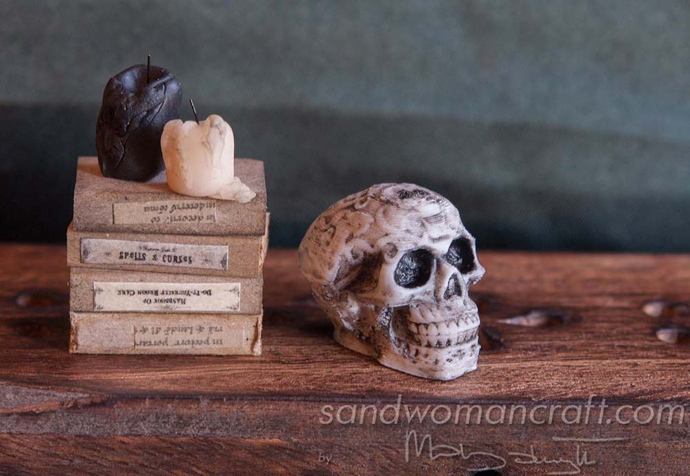 Miniature celtic skull, candles, books