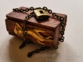 Miniature chest box with brass hand ornament