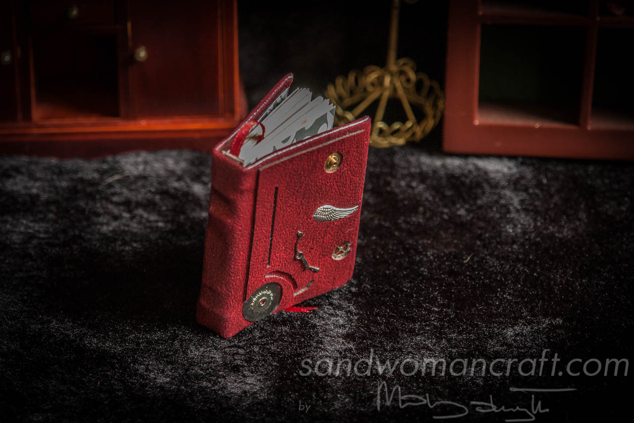 Miniature claret leather steampunk book