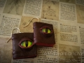 Miniature leather book earrings with glass dragon's eye cover