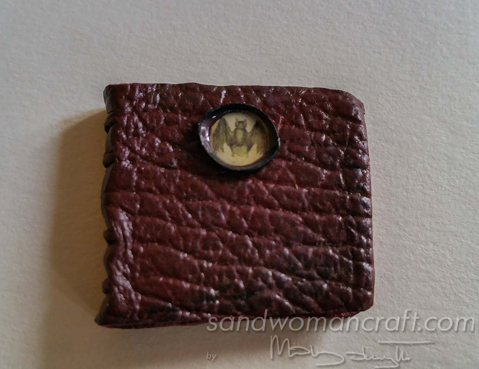 Miniature leather book with Bat