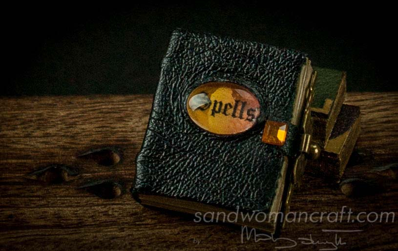 Miniature leather Book Of Spells witch orange glass cabochon