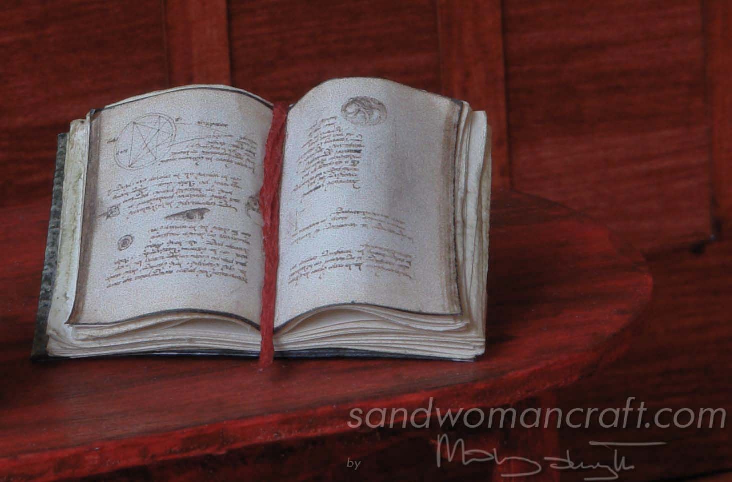 "Miniature open book ""Magic and spells"""