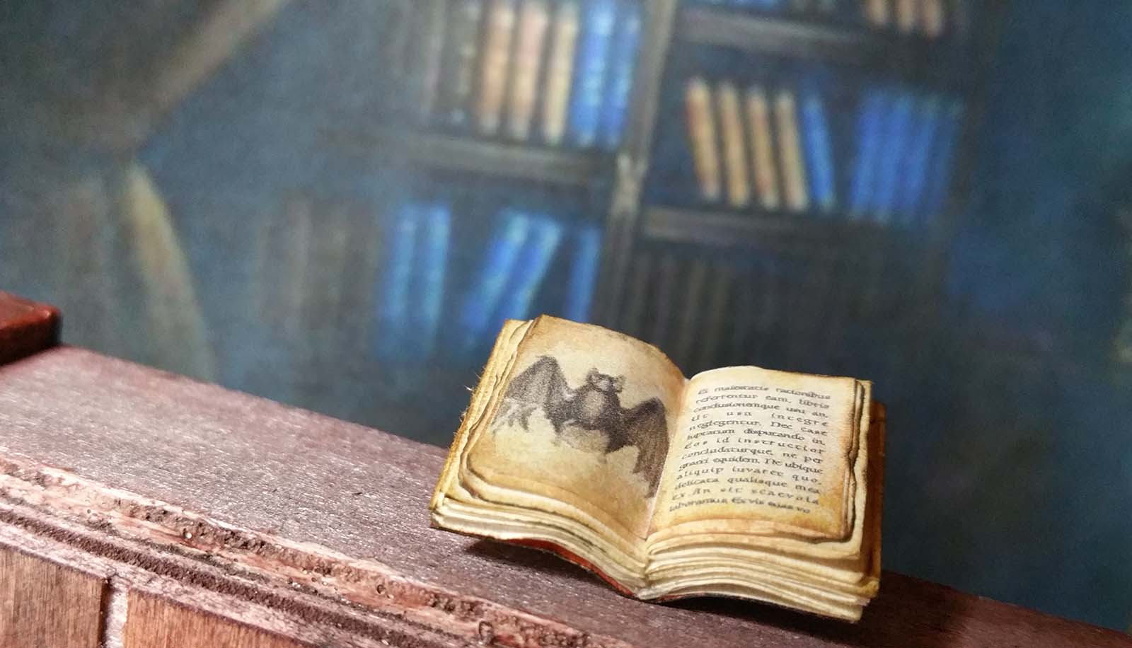 Miniature tiny open book with bat