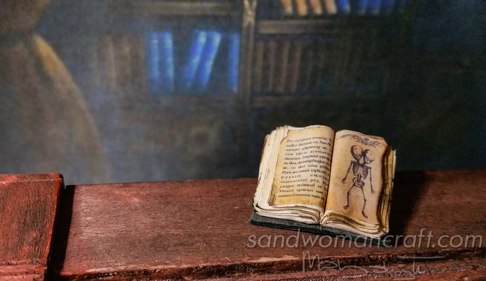 Miniature tiny open book. Creature with two heads