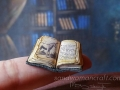 Miniature tiny open book with unicorn
