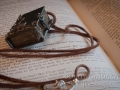 Miniature leather book necklace with filigree