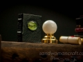 Miniature leather Book Of Spells with green cabochon