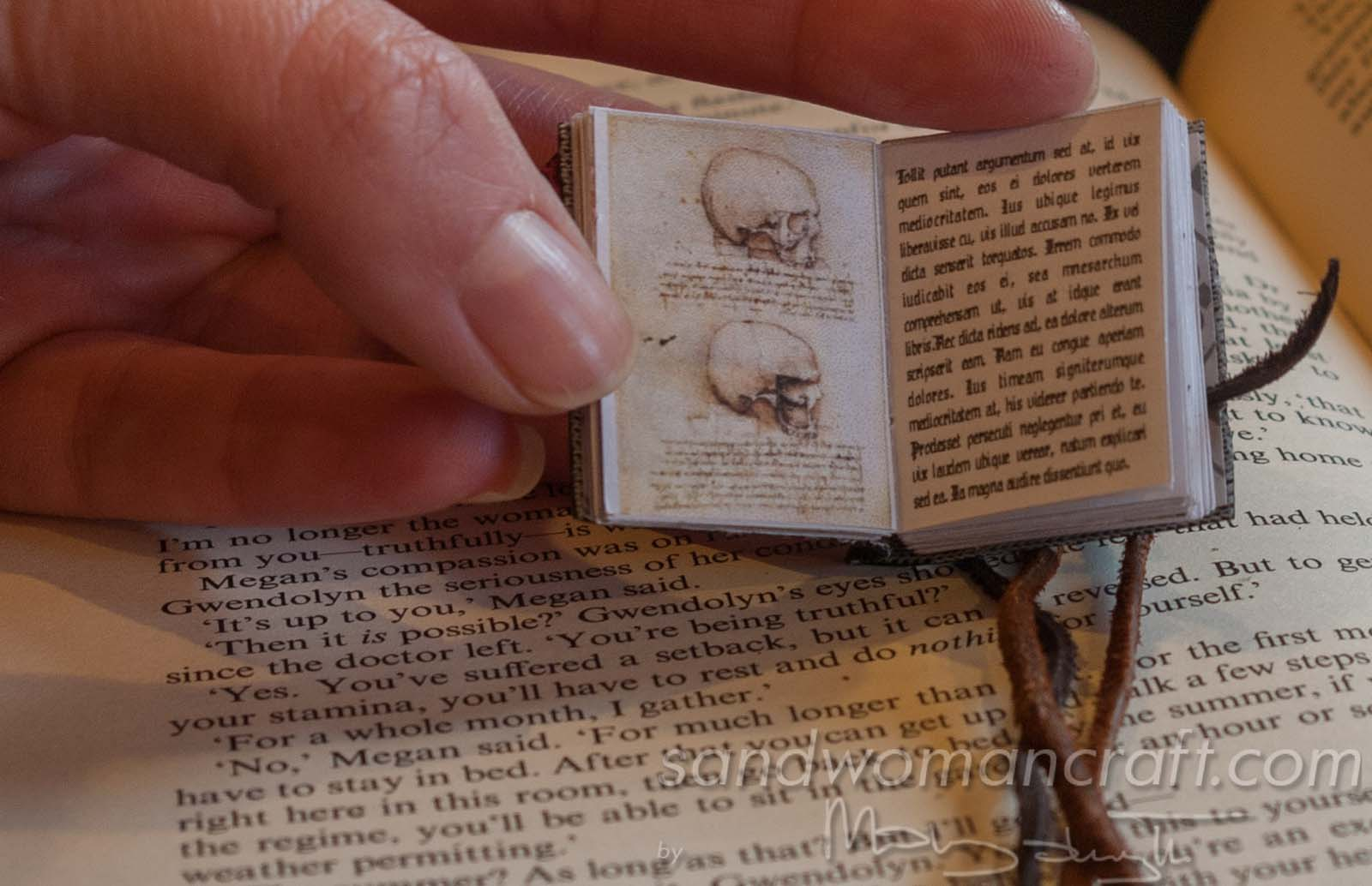 Miniature leather book necklace with real book to read inside. Da Vinci theme