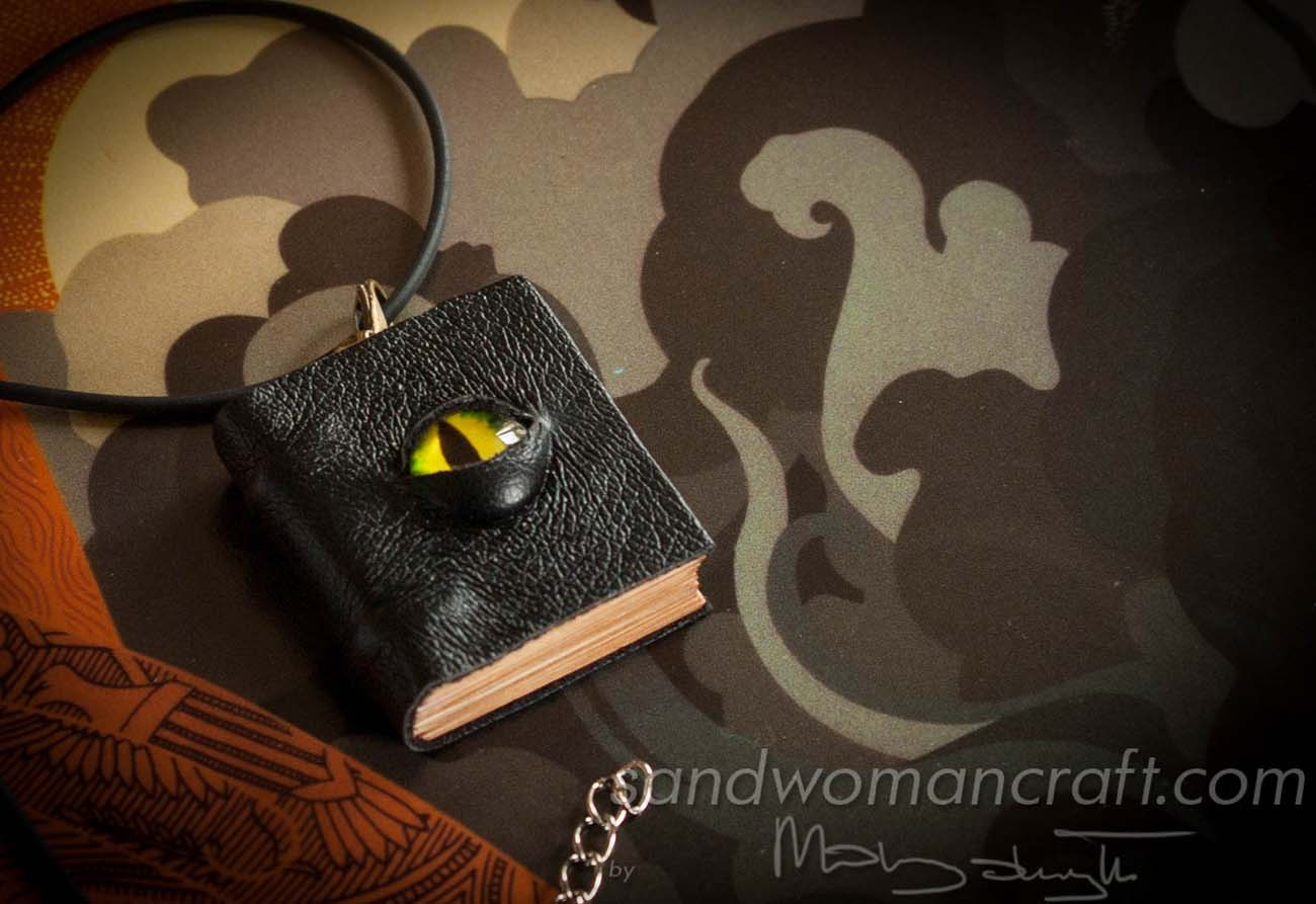 Miniature leather book necklace with green dragon's eye