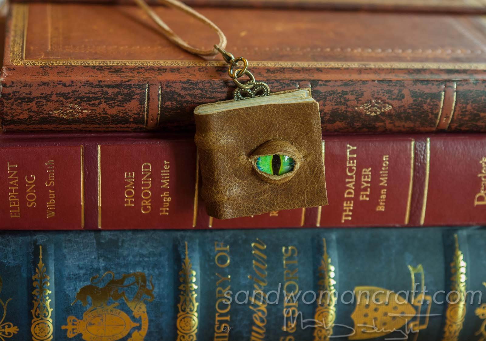 Miniature book necklace, olive-brown textured leather, front cover with glass Dragons's eye