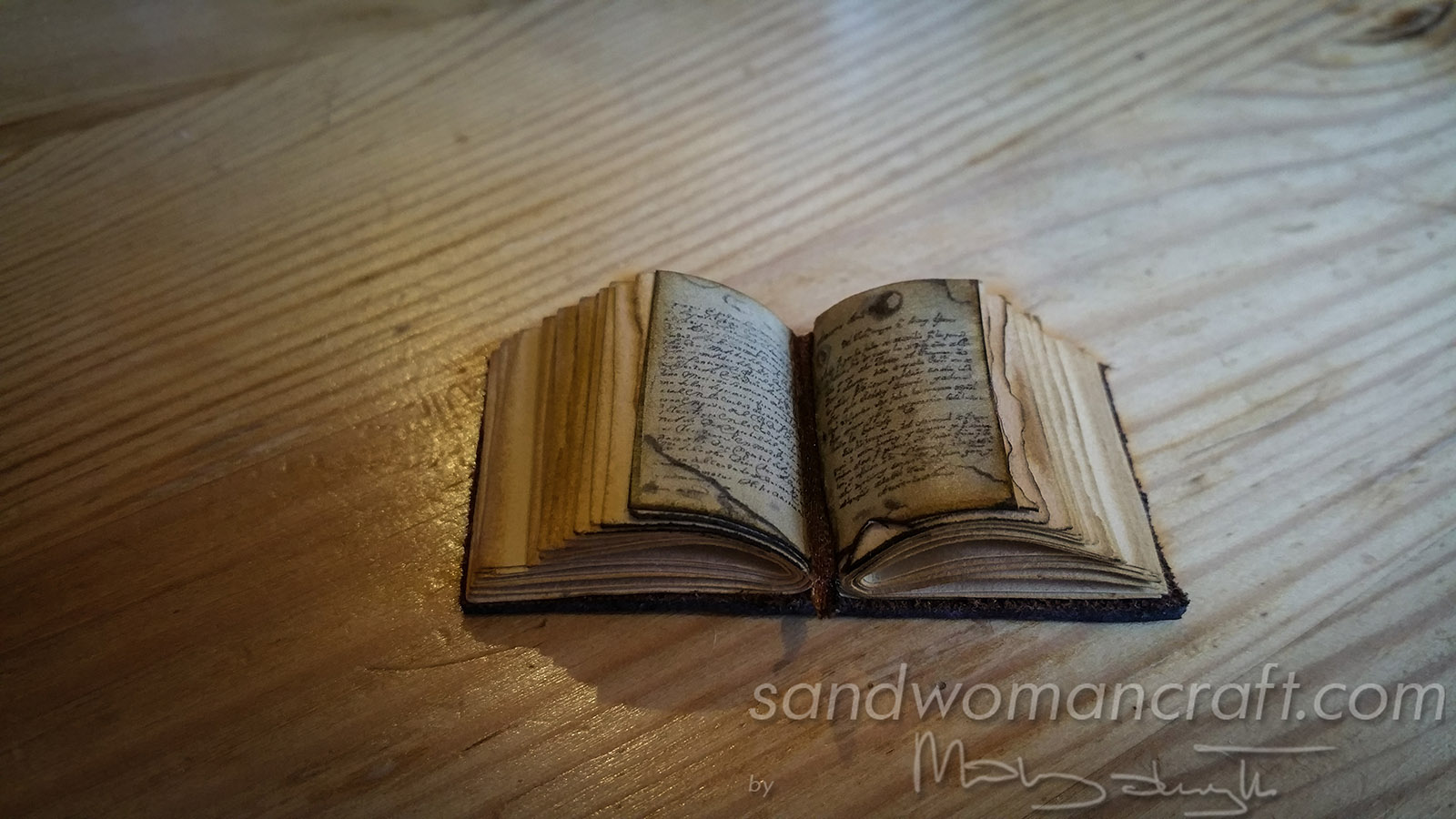 Miniature old thick leather book