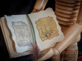 "Miniature open leather book ""History of magic"""
