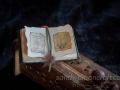 """Miniature open leather book """"History of magic"""""""