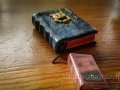 "Miniature books.  Blue leather with brass cat and Dostoyevsky's ""Crime and Punishment"""