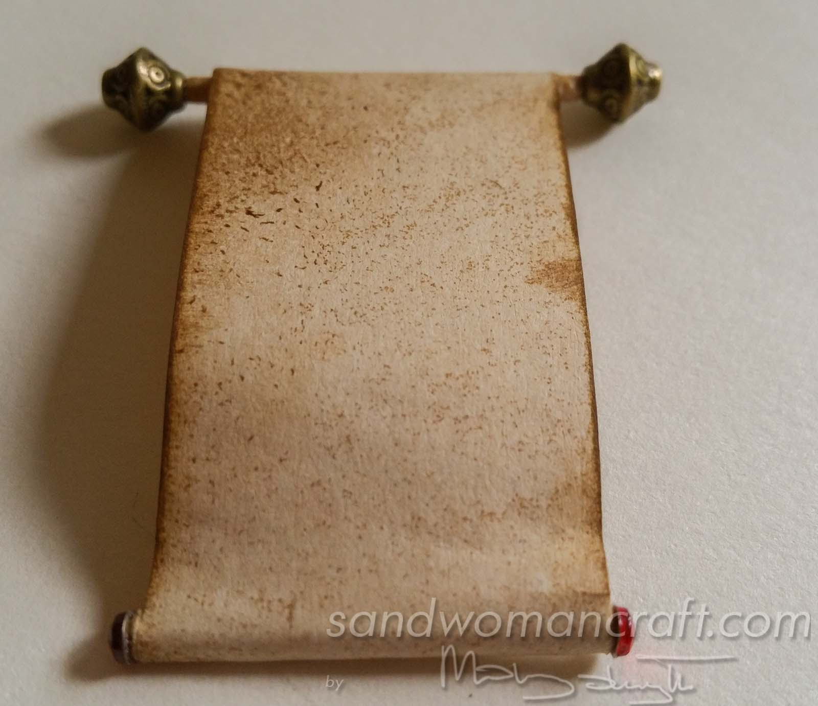 Miniature scroll on aged paper