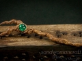 Miniature magic walking stick with horns and green glass stone