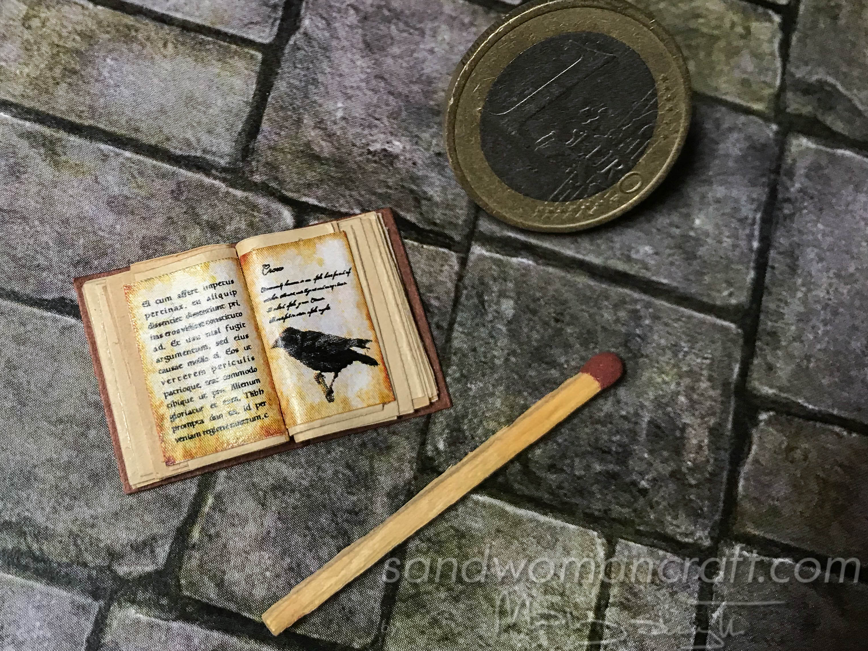 Miniature open book with Crow