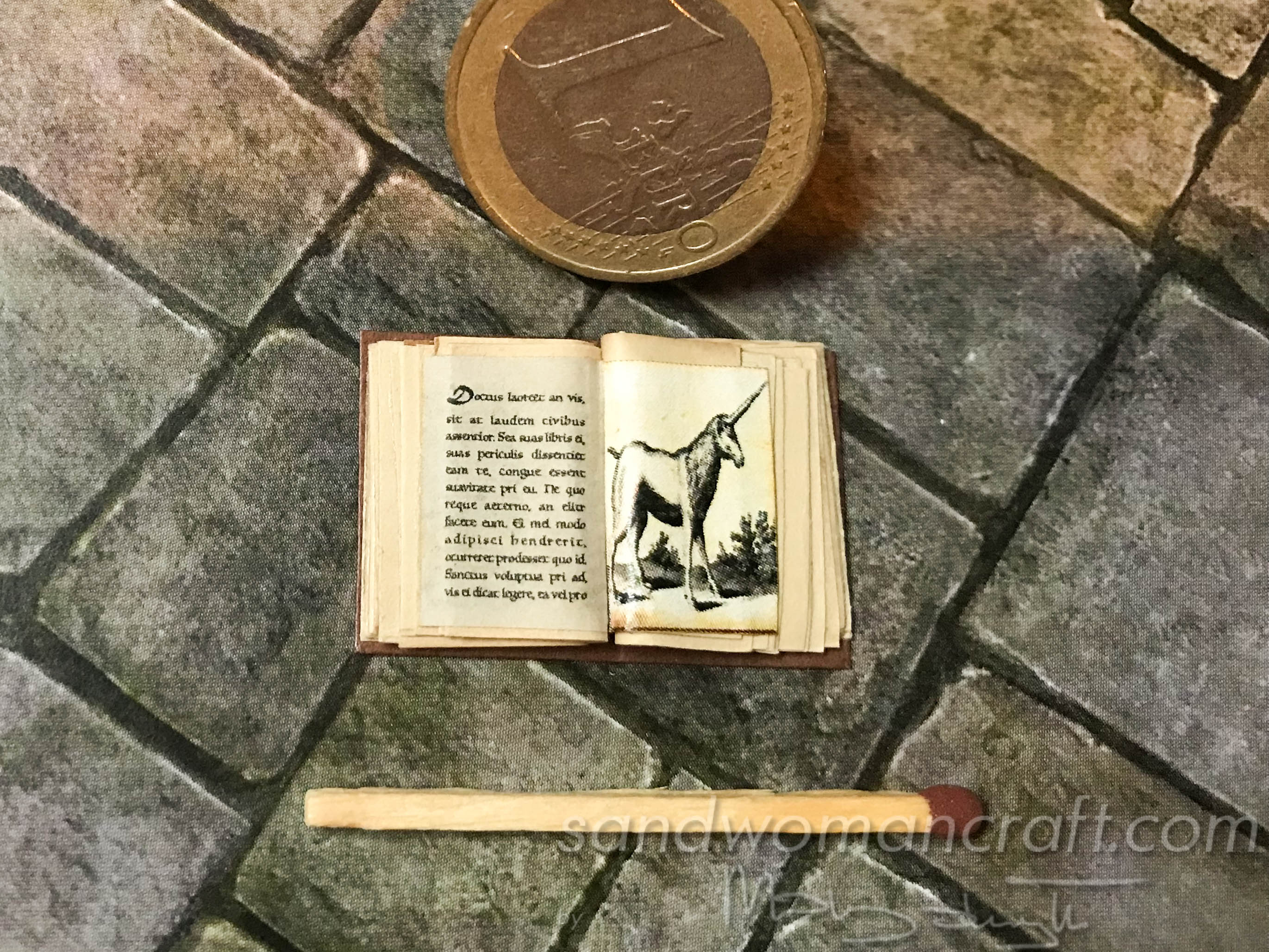 Miniature open book with Unicorn