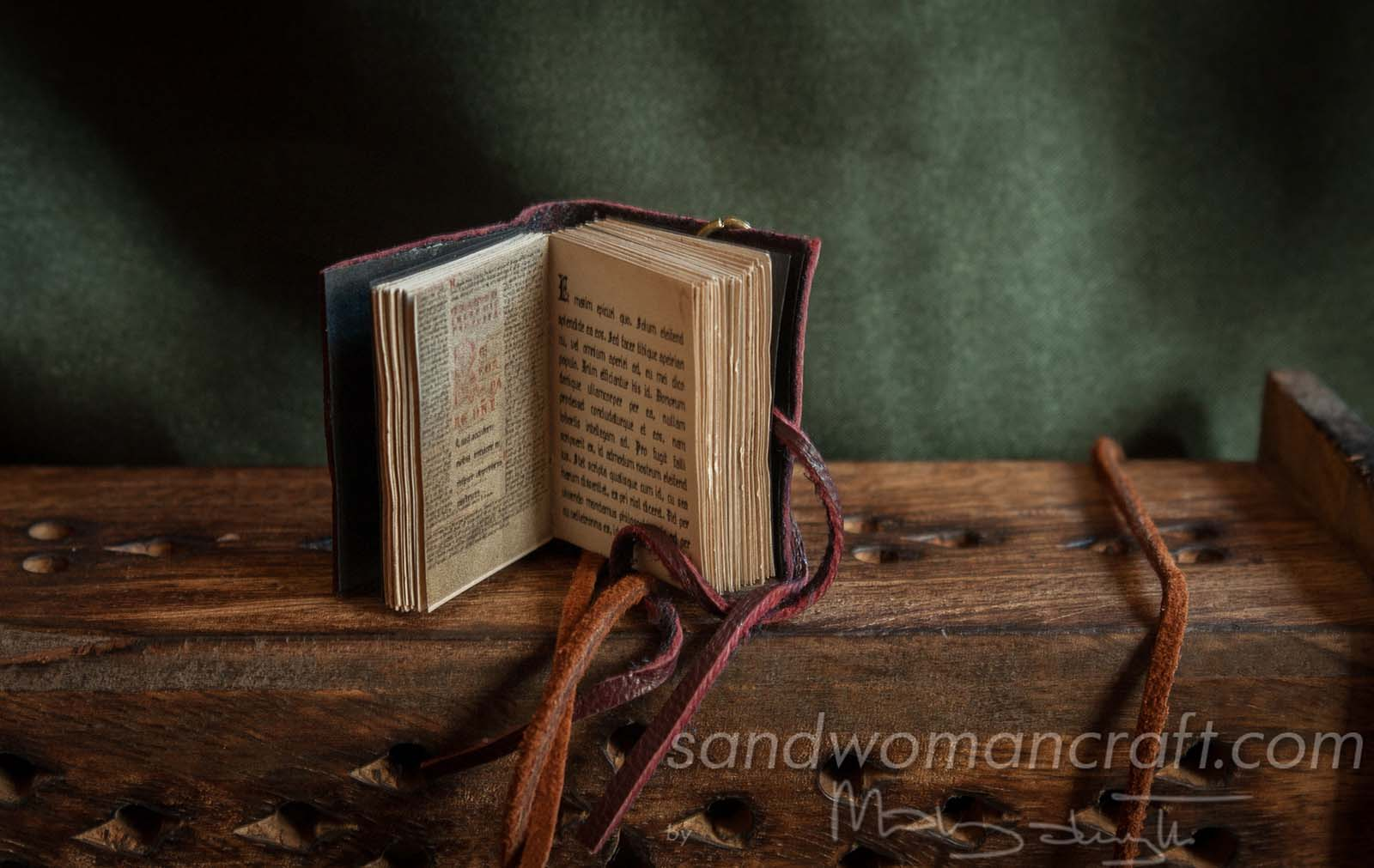 Miniature leather book necklace with real medieval book inside