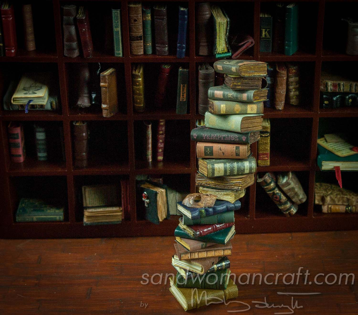 Pile/ stack/ set of 20 miniature books in 1:12 scale. Mostly aged books, mysterious mask attached.