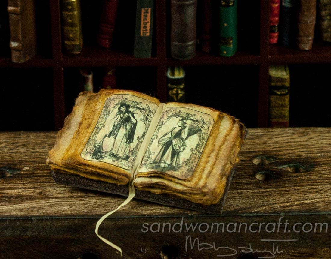 Miniature open book with Ladies Witches