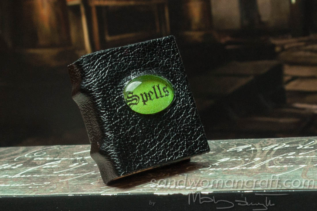 Miniature leather book of spells