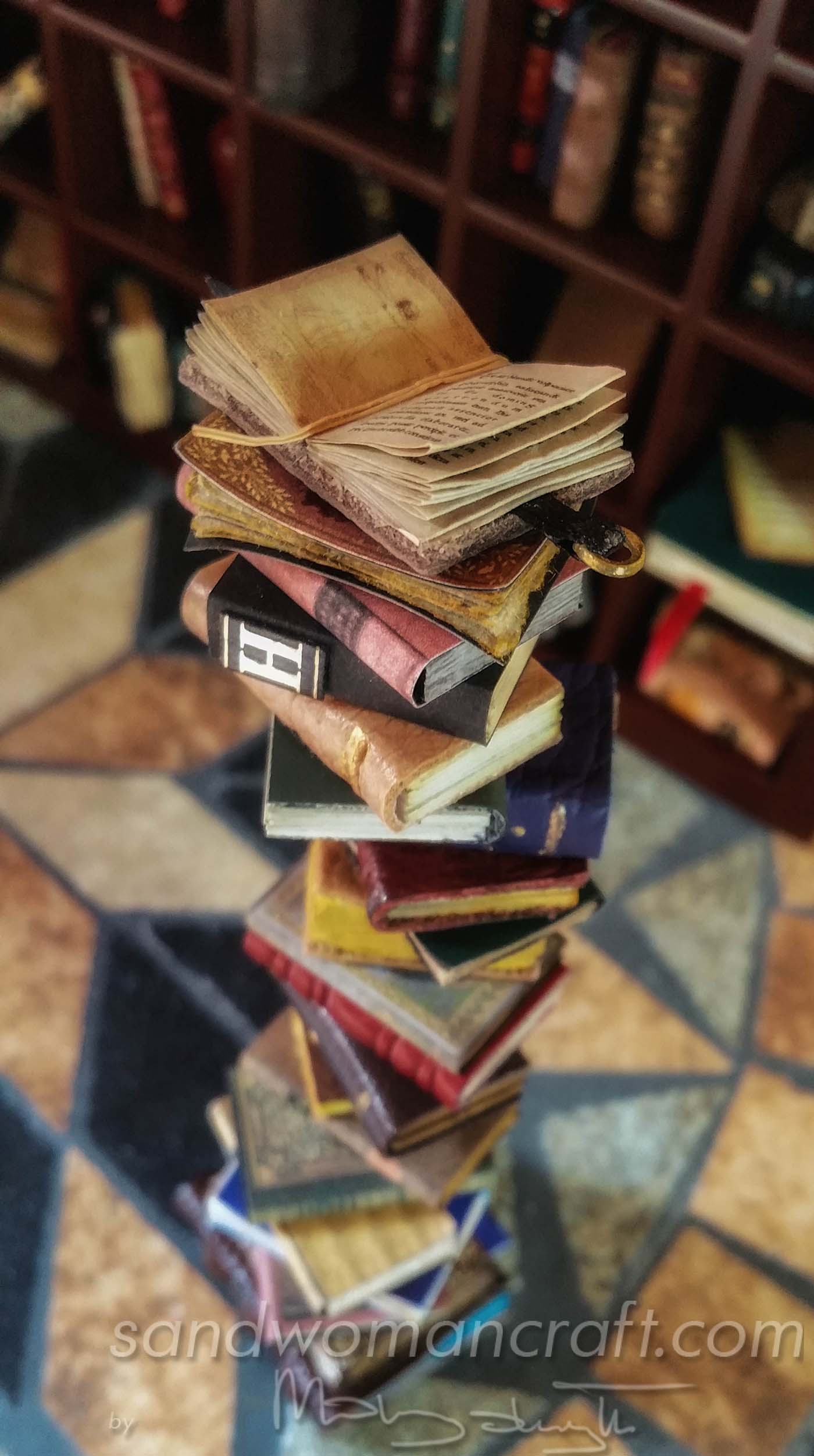 Miniature book stack with Da Vinci open book at the top