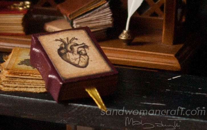 Miniature faux leather book with vintage heart
