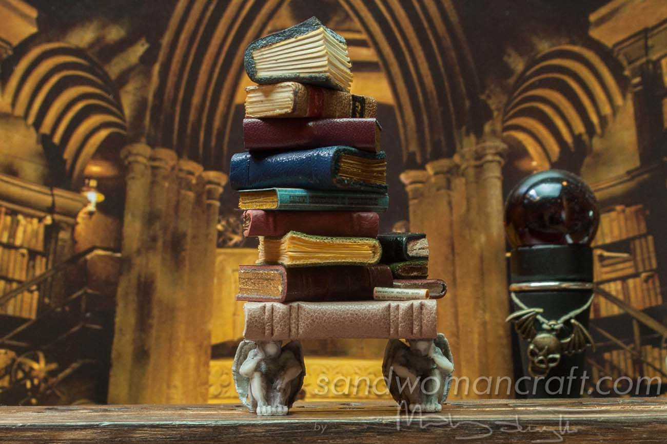 Miniature book stack with tiny Gargoyles