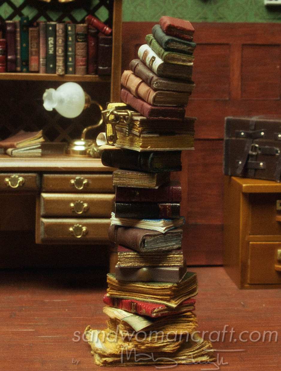 Miniature book stack with bunch of keys and aged papers