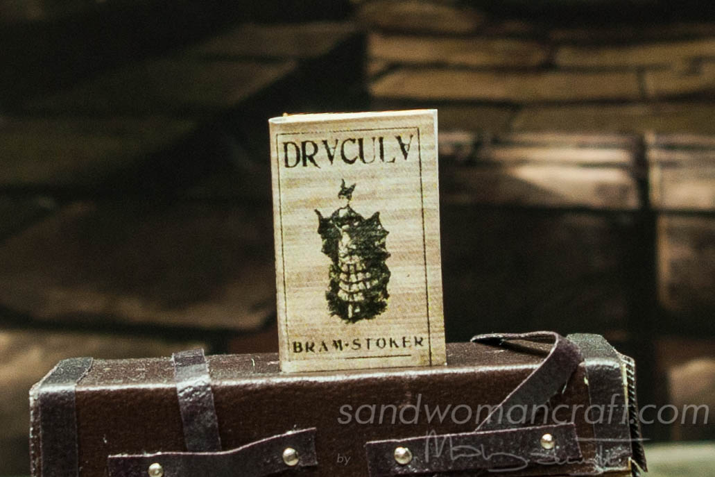 "Miniature book ""Dracula""."