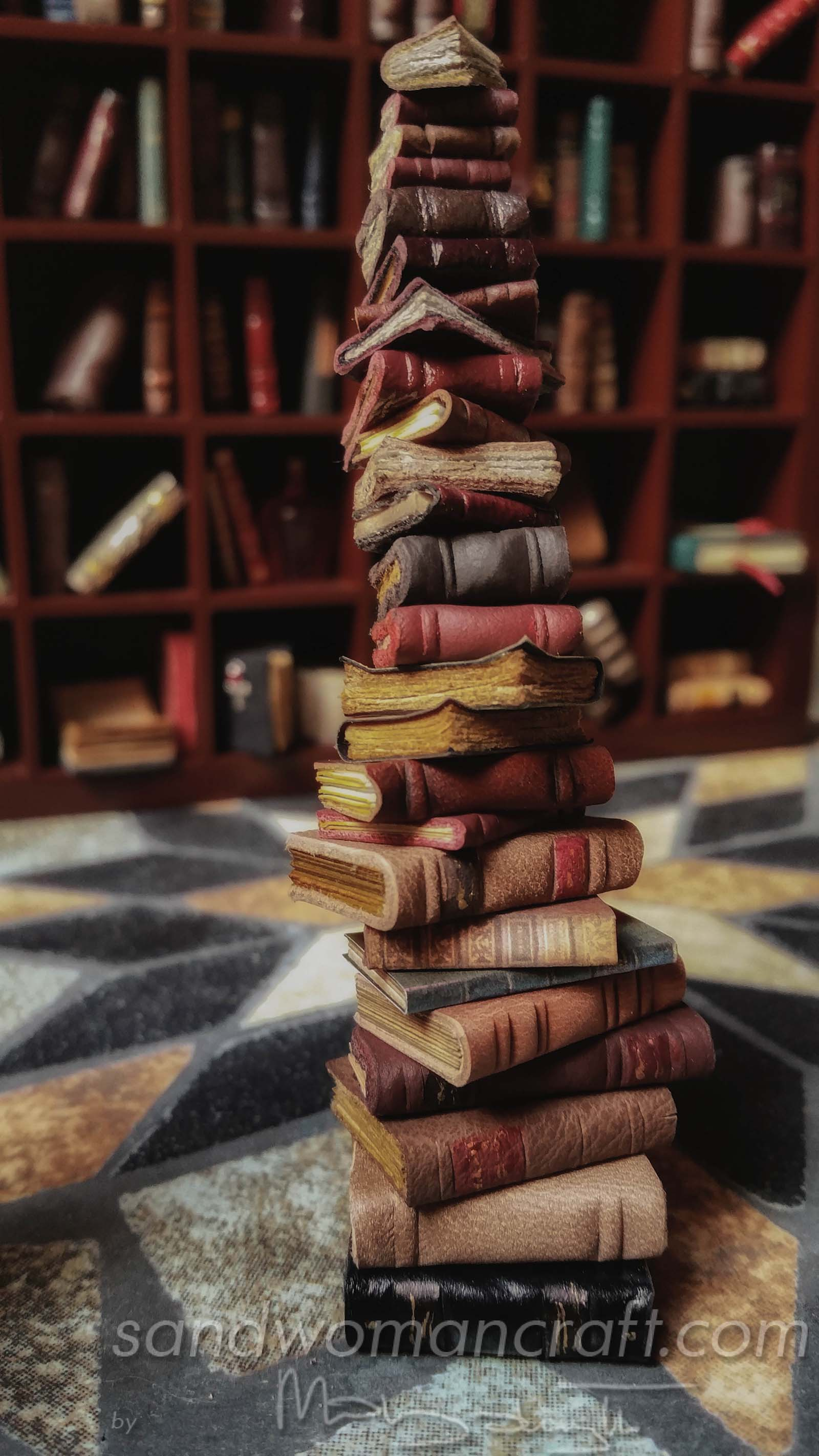 Miniature leather books stacked