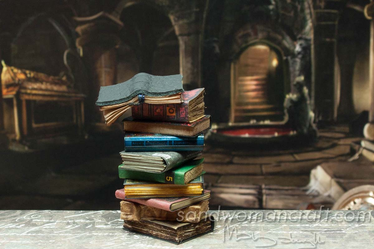 Miniature books stacked