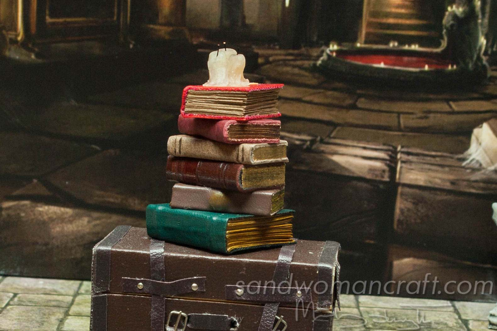 Miniature book stack with dripping candles and Spell Book