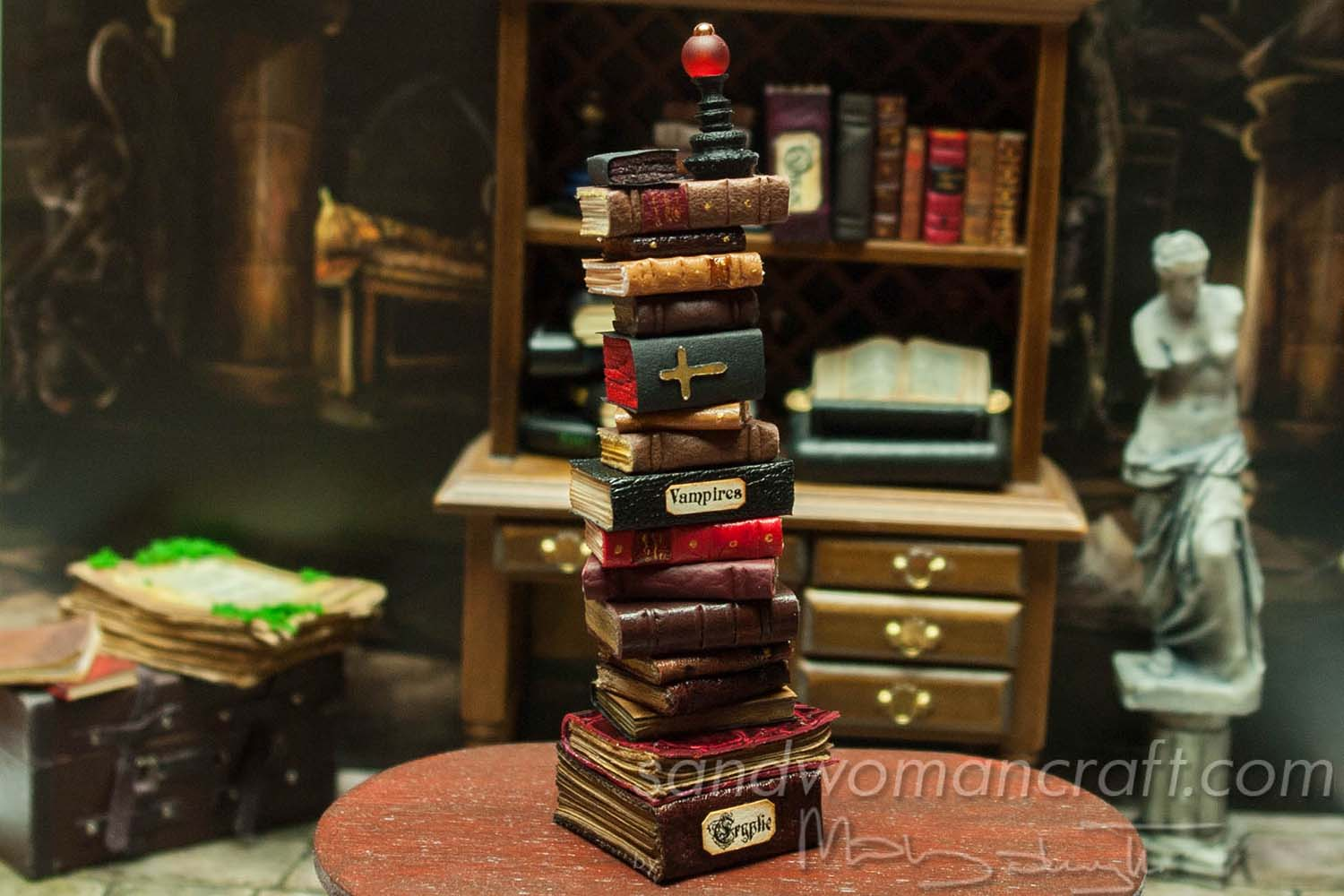 Miniature books stacked in 1:12 scale