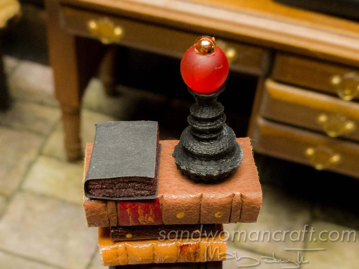 Miniature book stack with vampire's bottle potion