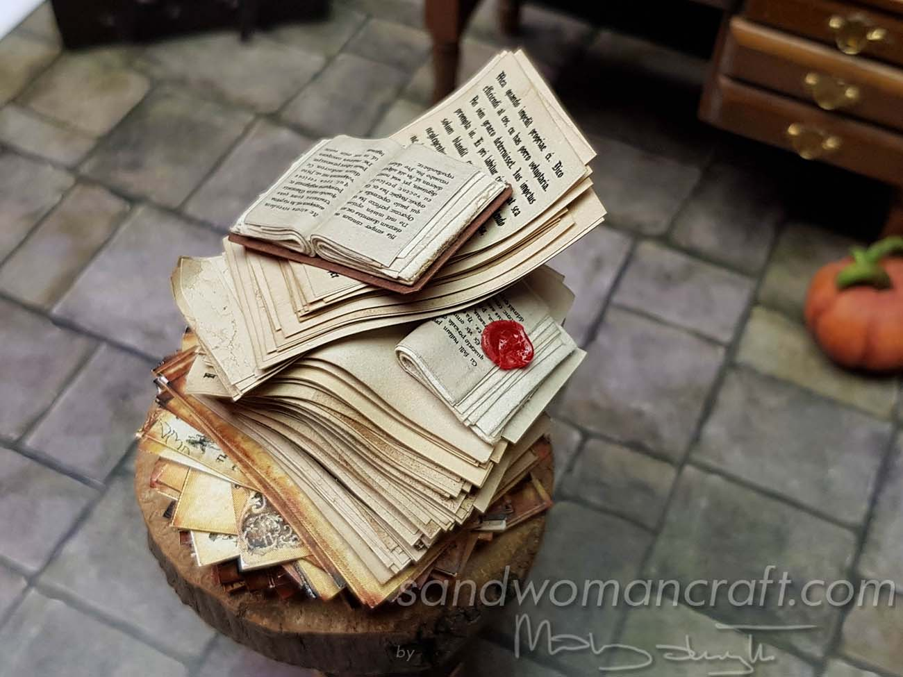 Aged papers stacked..with mini book at the top